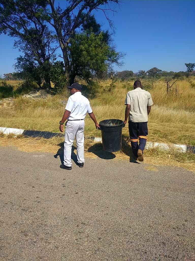 Matobo Hills Lodge Staff picking up litter