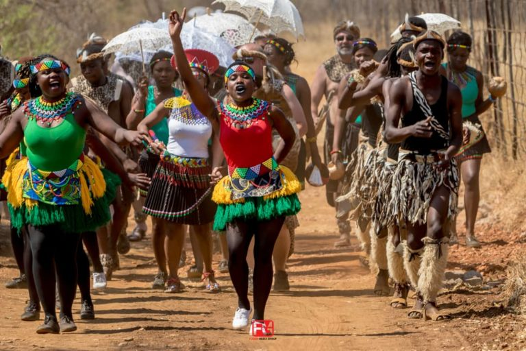Foreign tourists immersing themselves in a cultural dance of the Ndebele tribe in the Matobo Hills.